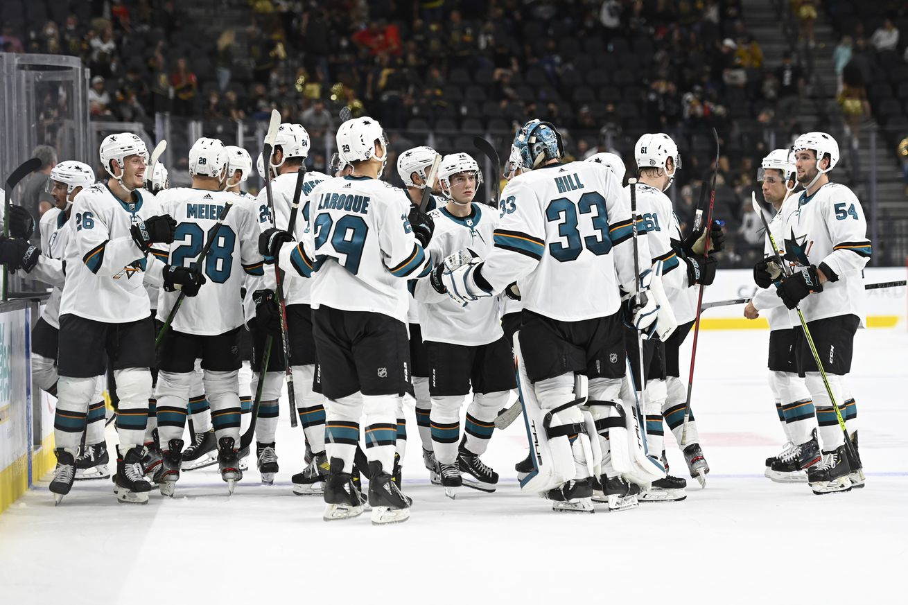 The San Jose Sharks celebrate after defeating the Vegas Golden Knights at T-Mobile Arena on September 26, 2021 in Las Vegas, Nevada.
