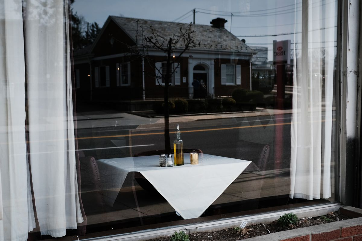 A table at a restaurant in New York sits empty.