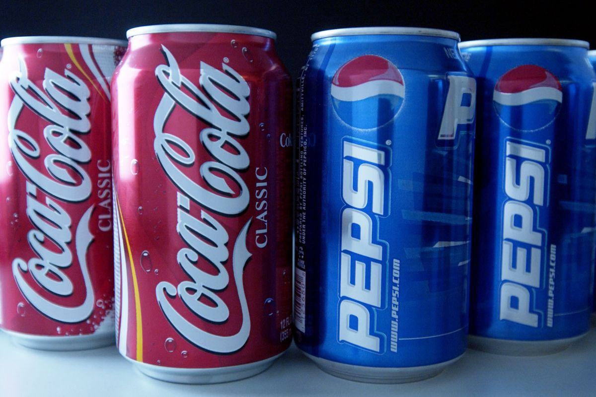 Cans of Pepsi and Coke are set up for a photograph in New Yo