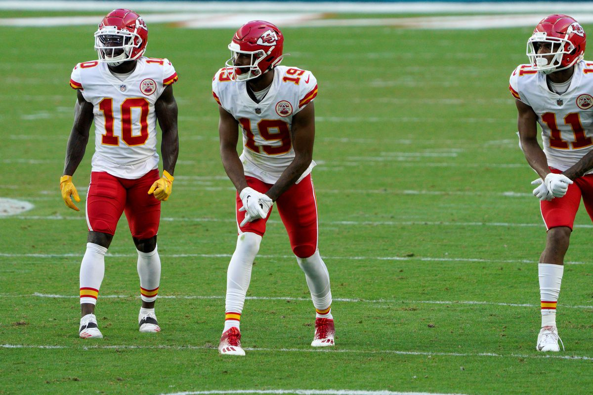 Tyreek Hill #10, Marcus Kemp #19, and Demarcus Robinson #11 of the Kansas City Chiefs line up in action against the Miami Dolphins at Hard Rock Stadium on December 13, 2020 in Miami Gardens, Florida.