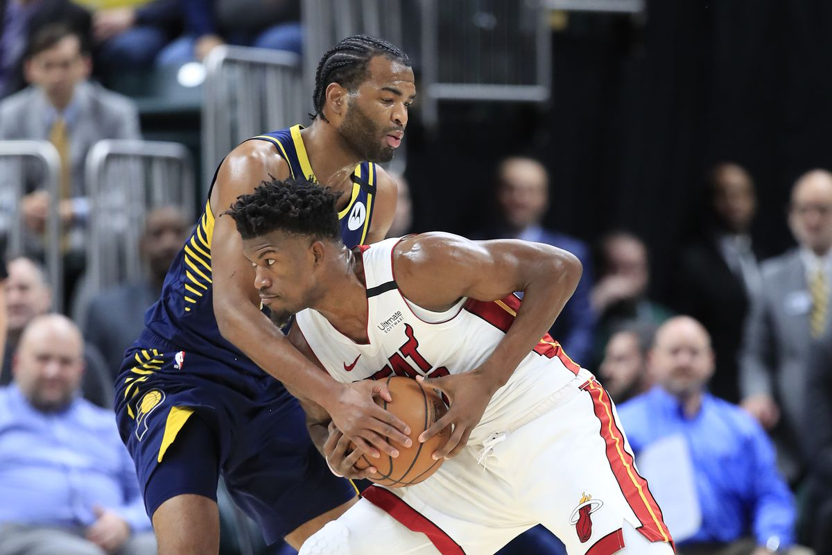 Jimmy Butler of the Miami Heat is defended by T.J. Warren of the Indiana Pacers during the game at Bankers Life Fieldhouse on January 08, 2020 in Indianapolis, Indiana.
