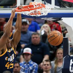 Utah Jazz guard Donovan Mitchell (45) dunks during the game against the Cleveland Cavaliers at Vivint Smart Home Arena in Salt Lake City on Saturday, Dec. 30, 2017.