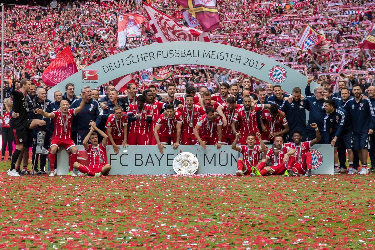 MUNICH, GERMANY - MAY 20: Players of Bayern Muenchen poses with the Championship trophy in celebration of the 67th German Championship title following the Bundesliga match between Bayern Muenchen and SC Freiburg at Allianz Arena on May 20, 2017 in Munich, Germany.