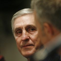 Utah Jazz coach Jerry Sloan looks at Greg Miller as he announces his resignation after being the head coach for the Jazz since 1988  Thursday, Feb. 10, 2011, in Salt Lake City, Utah.