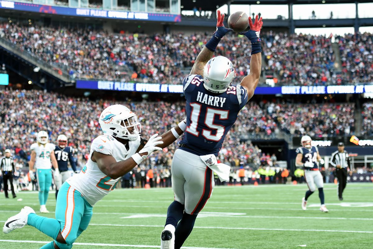 New England Patriots wide receiver N'Keal Harry makes a catch past Miami Dolphins defensive back Tae Hayes but is ruled out of bounds during the second half at Gillette Stadium