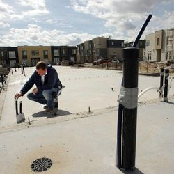 Construction manager Bart Caton looks over geothermal pipes at Garbett Homes in South Jordan on Tuesday, March 12, 2013.