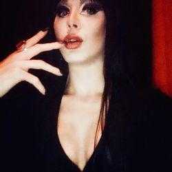 Lady Amalthea's (@ladyamaltheax) as Elvira, Mistress of the Dark on Oct. 2018.