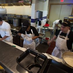 Kitchen staff preps for the onslaught of hungry patrons.
