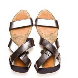 """<a href=""""http://www.michaelkors.com/store/catalog/prod.jhtml?itemId=prod9990127&parentId=cat130&masterId=cat121&index=16&cmCat=cat000000cat121cat130"""" rel=""""nofollow"""">Kors Michael Kors Willo sandals</a>, $125"""