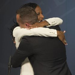 Mia Love is hugged by her husband, Jason Love, after debating Doug Owens at the Dolores Doré Eccles Broadcast Center on the University of Utah campus in Salt Lake City on Tuesday, Oct. 14, 2014.