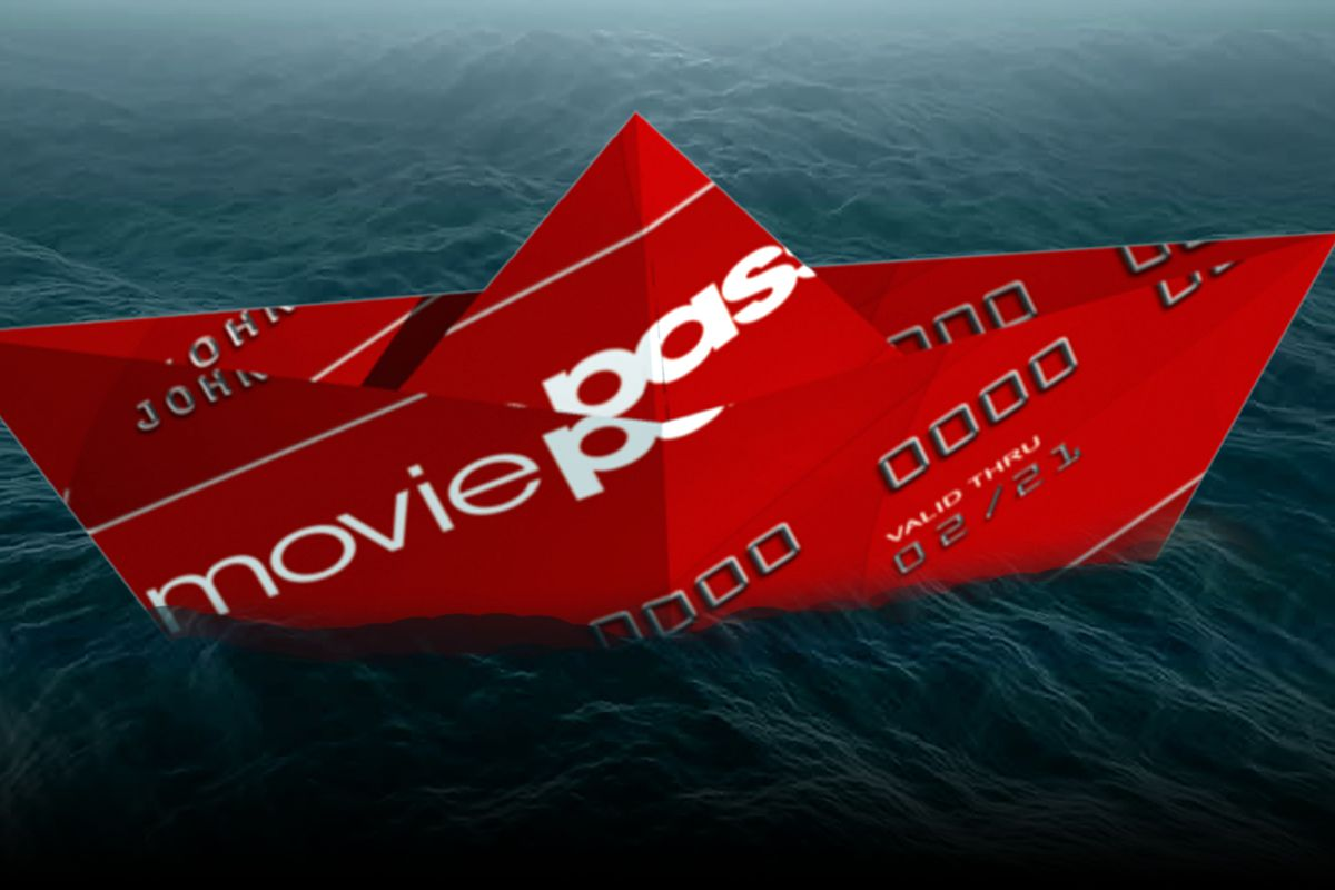 An illustration of a MoviePass debit card in water, folded up like an origami boat.