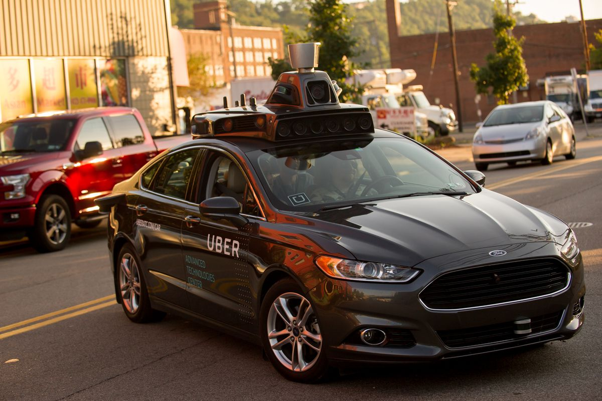 An Uber Driverless Ford Fusion Drives Down Smallman Street On September 22 2016 In Pittsburgh Pennsylvania Jeff Swensen Getty Images