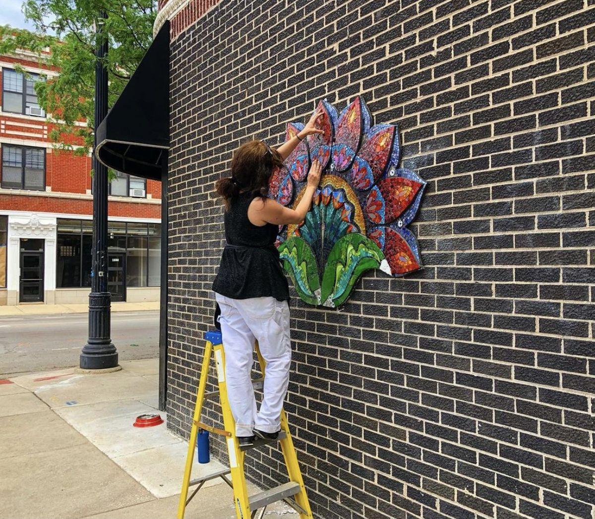 "Chicago Mosaic School faculty member Casey Van Loon installs her piece ""Lotus"" at 1259 W. Devon Ave."