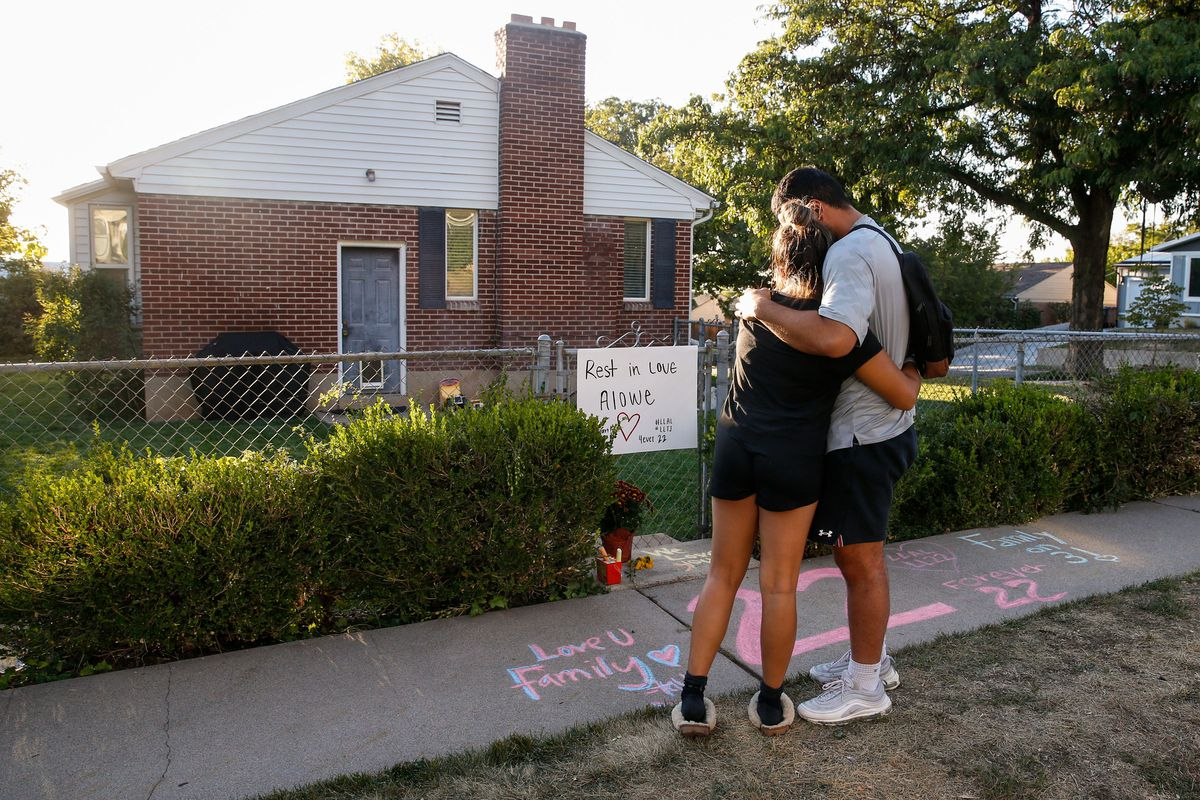 Samuelu Elisaia, right, former University of Utah football player and teammate of sophomore defensive back Aaron Lowe and University of Utah student, Madison Jacobus embraces each other infront of a makeshift memorial at the incident of shooting on Sunday, Sept. 26, 2021 in Salt Lake City's Sugar House neighborhood. University of Utah sophomore and football defensive back Aaron Lowe was shot and killed early Sunday morning during a house party.