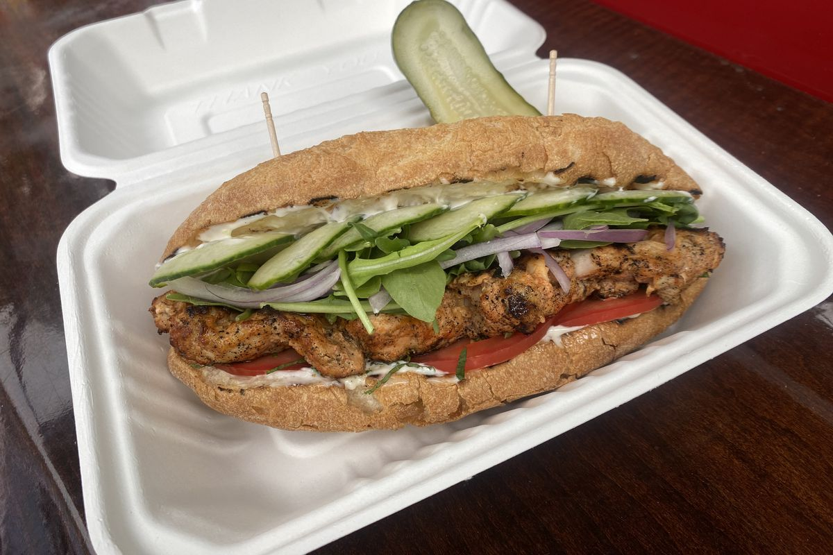 A sandwich layered with cucumbers and tomatoes from Boy Howdy in Portland, Oregon