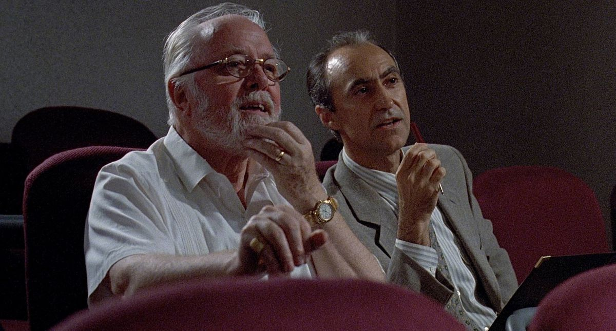 John Hammond and his lawyer Gennaro watch the DNA explainer video in Jurassic Park