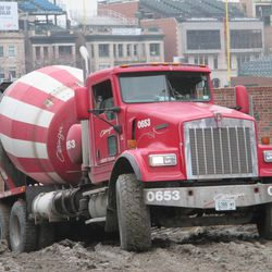 Concrete mixing truck backing into the left-field corner