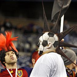 Real fan Randolf Scott takes a look at Phil Andruss' mohawk before Real Salt Lake and the Los Angeles Galaxy play soccer in the MLS Cup final at Qwest Field Sunday, Nov. 22, 2009, in Seattle.