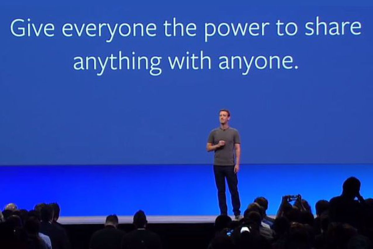"""Facebook CEO Mark Zuckerberg onstage in front of a backdrop that reads """"Give everyone the power to share anything with anyone."""""""