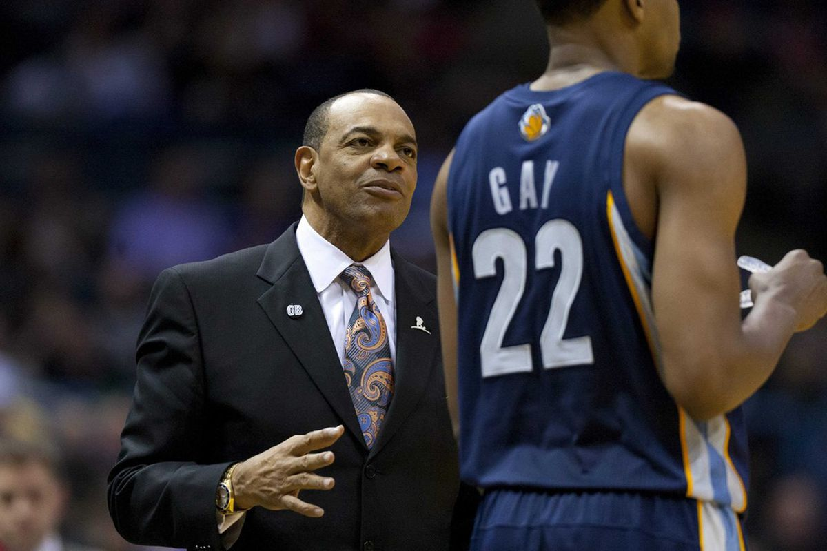 Mar 31, 2012; Milwaukee, WI, USA;  Memphis Grizzlies head coach Lionel Hollins stares magically at Rudy Gay, implanting magical fairy dust to make Gay an automatic 30-point superstar
