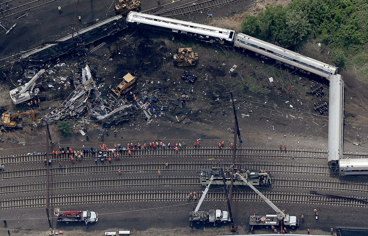 Investigators and first responders work near the wreckage of Amtrak Northeast Regional Train 188, from Washington to New York, that derailed yesterday May 13, 2015 in north Philadelphia, Pennsylvania. At least six people were killed and more than 200 others were injured in the crash. (Photo by Win McNamee/Getty Images)