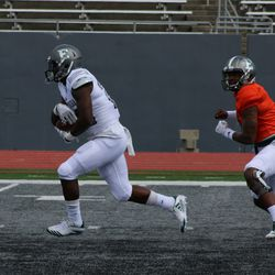One of the Eastern Michigan running backs taking the handoff from Aaron Jackson.