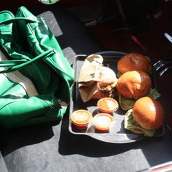 The wild card burgers with containers of special sauce