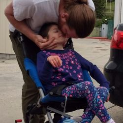 Andrew Williams gives his daughter, Amy Nicole Williams, a kiss at Shriners Hospitals for Children - Salt Lake City on Friday, May 26, 2017. The pediatric hospital staff started the Special Needs Car Seat Clinic to give customized car seats to patients with orthopedic conditions.