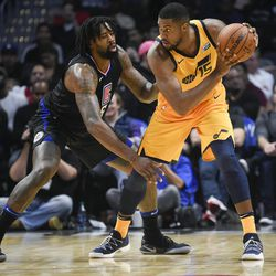 Utah Jazz forward Derrick Favors, right, handles the ball as Los Angeles Clippers center DeAndre Jordan defends during the second half of an NBA basketball game in Los Angeles, Thursday, Nov. 30, 2017. The Jazz won 126-107. (AP Photo/Kelvin Kuo)