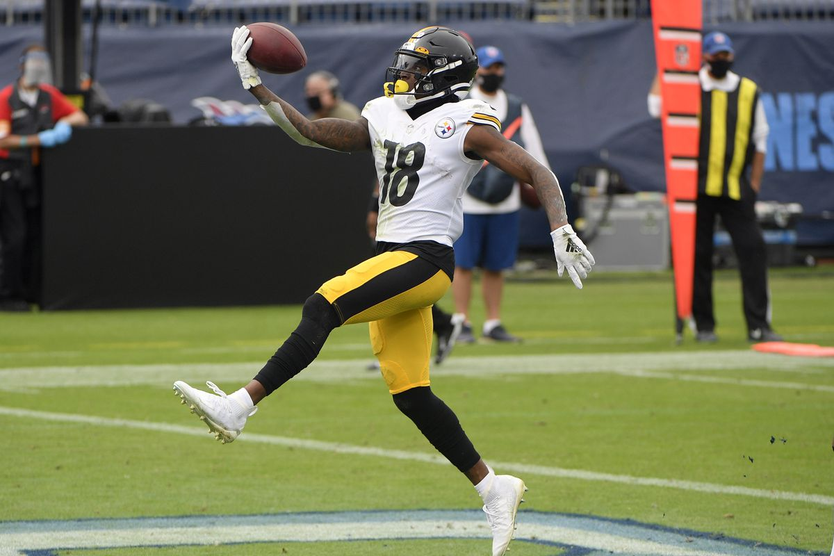 Pittsburgh Steelers wide receiver Diontae Johnson (18) flips the ball as he scores against the Tennessee Titans during the first half at Nissan Stadium.