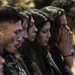 Mourners attend a memorial service at the Allen Temple Baptist Church Tuesday, April 3, 2012, in Oakland, Calif. Several hundred people gathered Tuesday night for a prayer vigil for the victims of Monday's shooting at Oikos University, a small Christian school in Oakland.