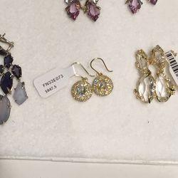 18K gold earrings, $947