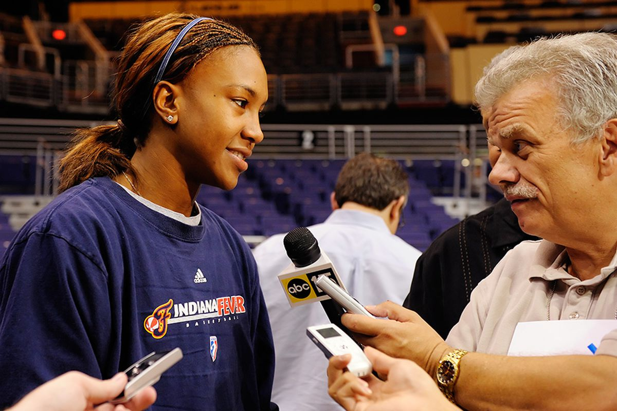 Indian Fever star forward Temika Catchings answers questions from the media before practice. The Fever face the Phoenix Mercury in the WNBA Finals. <em>Photo by Max Simbron</em>