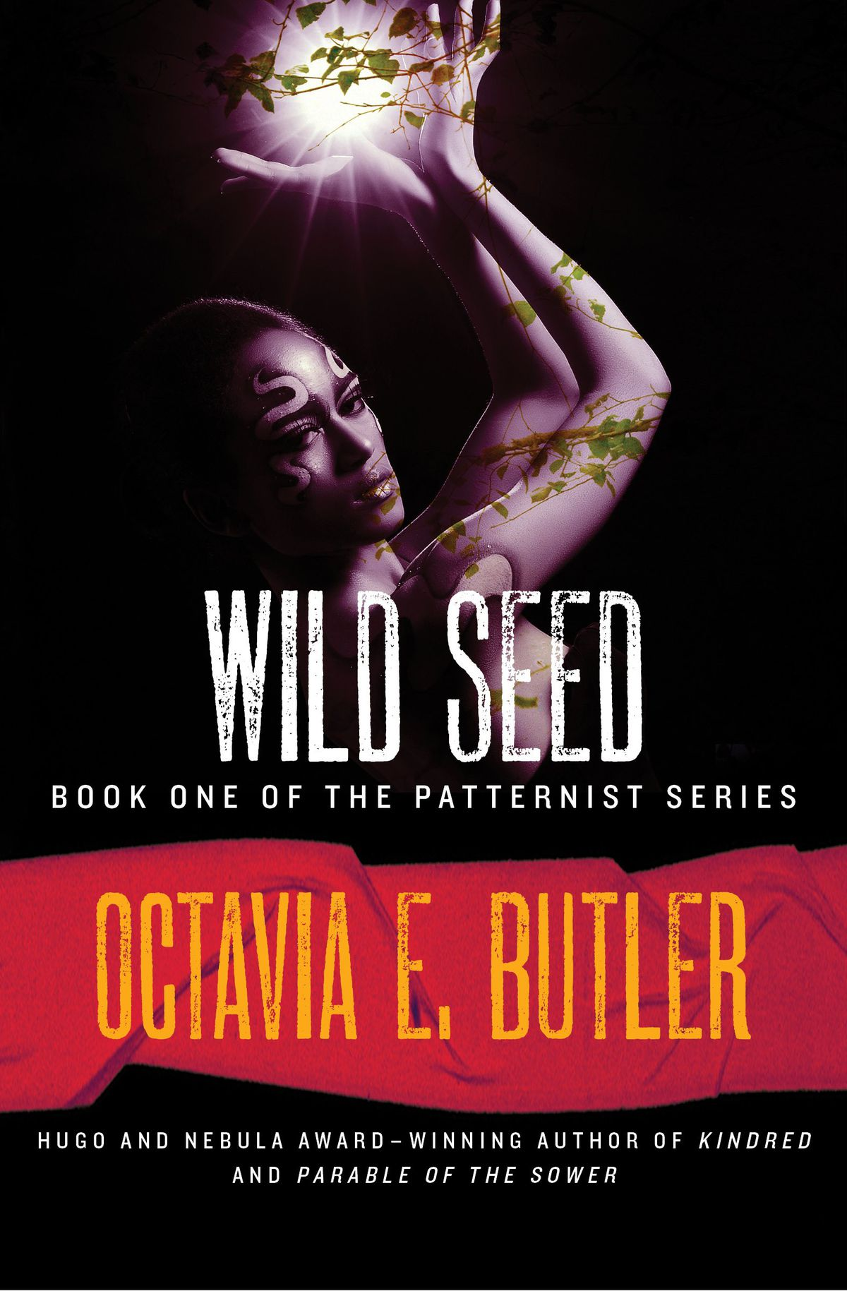 The cover of Octavia Butler's Wild Seed, with a Black woman with snakes tattooed on her face holding up her hands and cupping vines