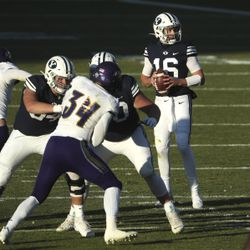 Brigham Young Cougars quarterback Baylor Romney (16) looks for a receiver during a game against North Alabama in Provo on Saturday, Nov. 21, 2020.