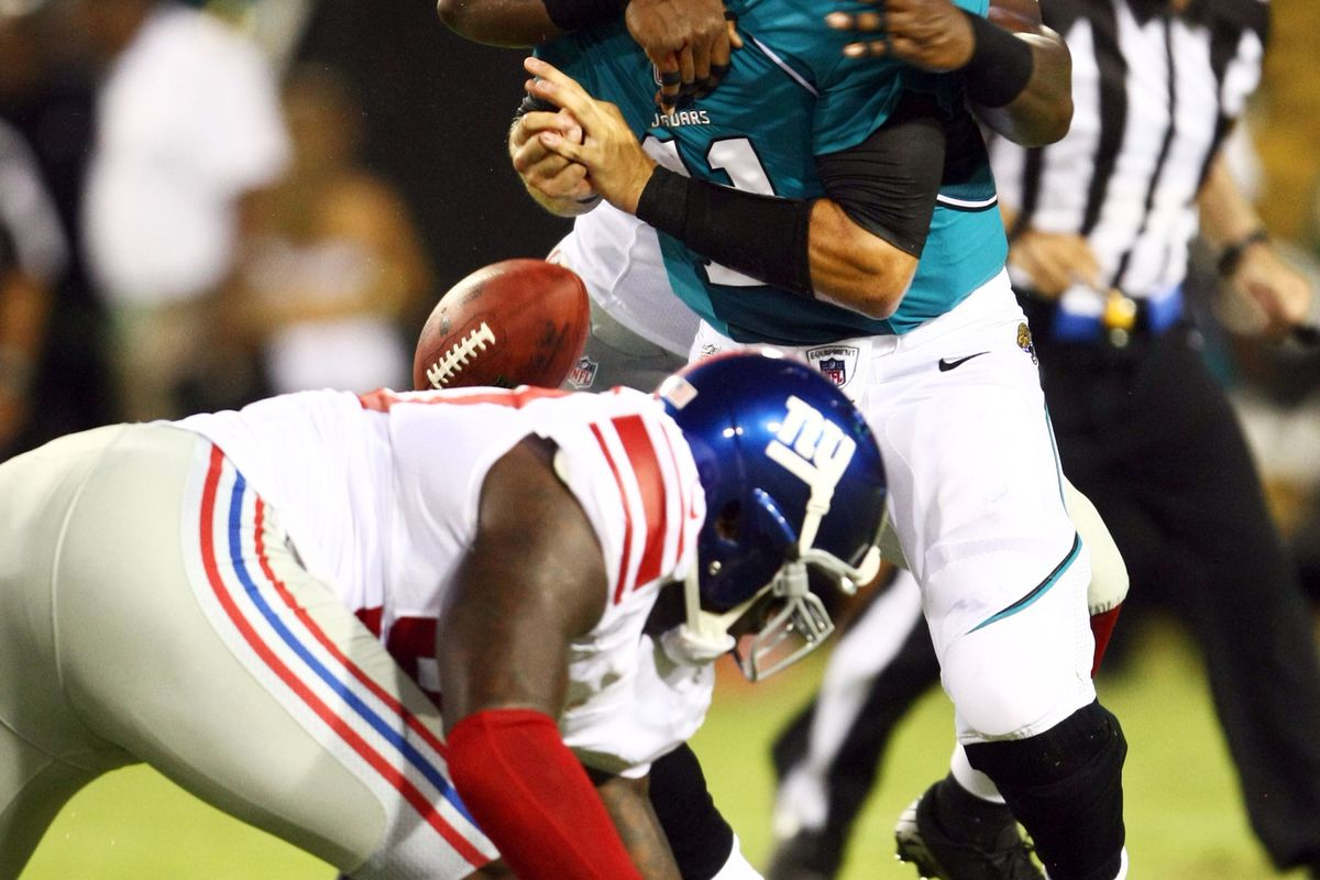Aug 10, 2012; Jacksonville FL, USA; New York Giants linebacker Adrian Tracy (98) sacks Jacksonville Jaguars quarterback Blaine Gabbert (11) and causes a turnover during the second quarter at EverBank Field. Douglas Jones-US PRESSWIRE