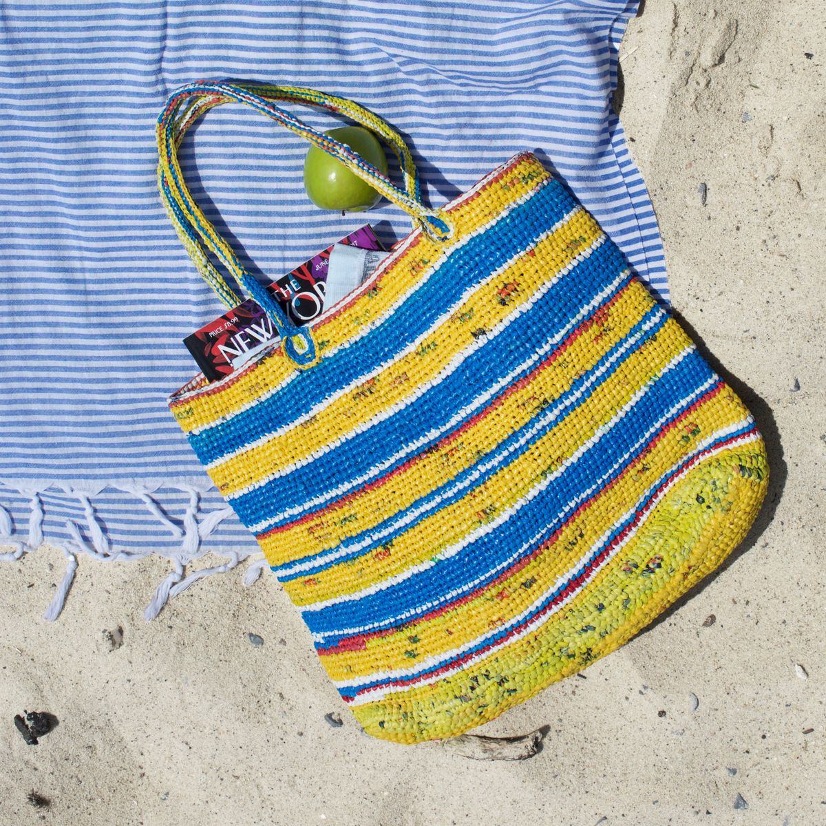 a yellow and blue striped bag