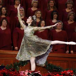 A dancer performs at the annual Christmas Concert at the LDS Conference Center Friday.