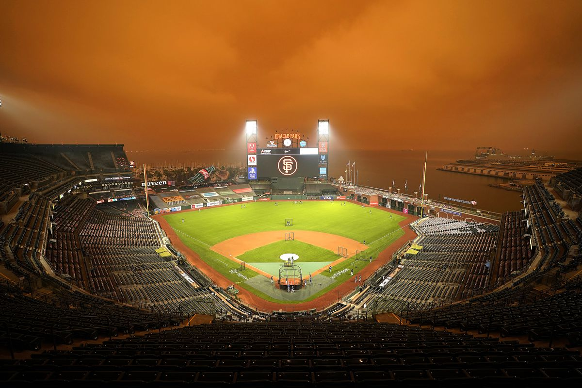Smoke from California wildfires obscures the sky over Oracle Park as the Seattle Mariners take batting practice before their baseball game against the San Francisco Giants on Wednesday, Sept. 9, 2020, in San Francisco.