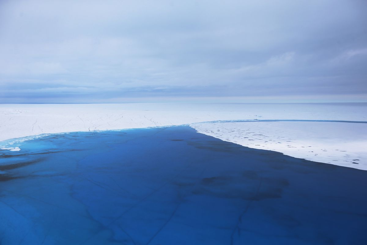 Water covering Greenland's ice sheet.
