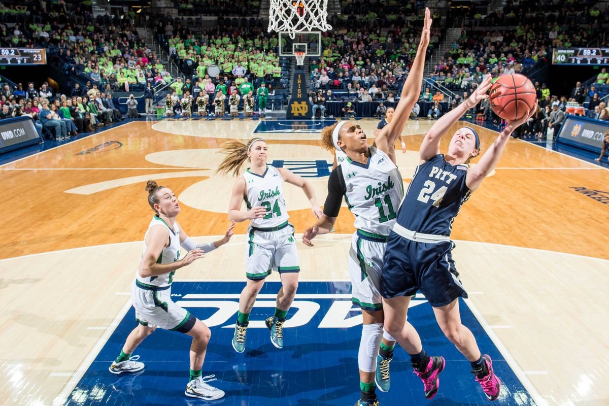 Freshman Brianna Turner (foreground in white) led the Irish with 15 points and 9 rebounds against Pitt.