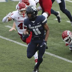 Utah State Aggies wide receiver Savon Scarver (11) runs for the touchdown on a kickoff return against the Fresno State Bulldogs in Logan on Saturday, Nov. 14, 2020.