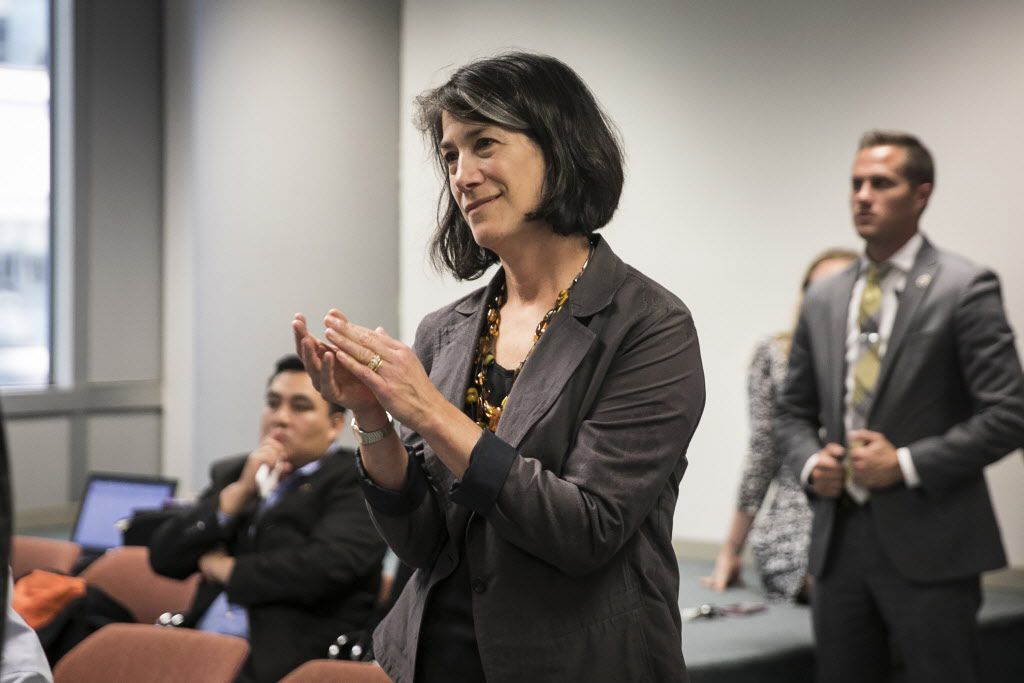 First lady Diana Rauner smiles and applauds from the back of the room as Gov. Bruce Rauner announces he will sign abortion legislation HB40. | Ashlee Rezin/Sun-Times