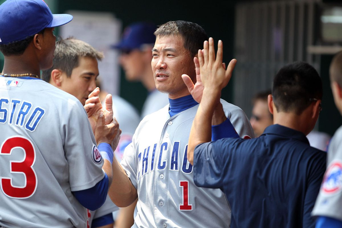 Happy Cubs: Kosuke Fukudome of the Chicago Cubs is congratulated by Starlin Castro after scoring a run during the game against the Cincinnati Reds at Great American Ball Park on June 8, 2011 in Cincinnati, Ohio.  (Photo by Andy Lyons/Getty Images)