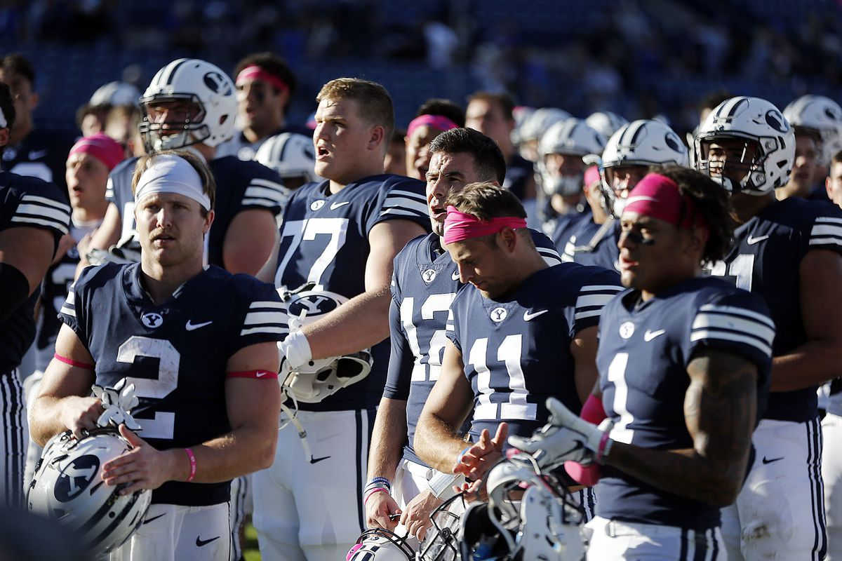 The Brigham Young Cougars join with students and sing after losing to the Northern Illinois Huskies in NCAA football in Provo on Saturday, Oct. 27, 2018.