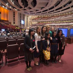 Sister missionaries pose for a photo prior to the 184th Annual General Conference Saturday, April 5, 2014, at the Conference Center in Salt Lake City.