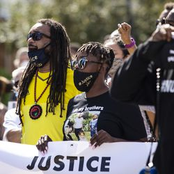 Justin Blake and Letetra Wideman, Jacob Blake's uncle and sister, join other members of their family and hundreds of supporters to march through the streets of Kenosha, six days after Jacob Blake was shot in the back by a police officer in the Wisconsin city, Saturday, Aug. 29, 2020.