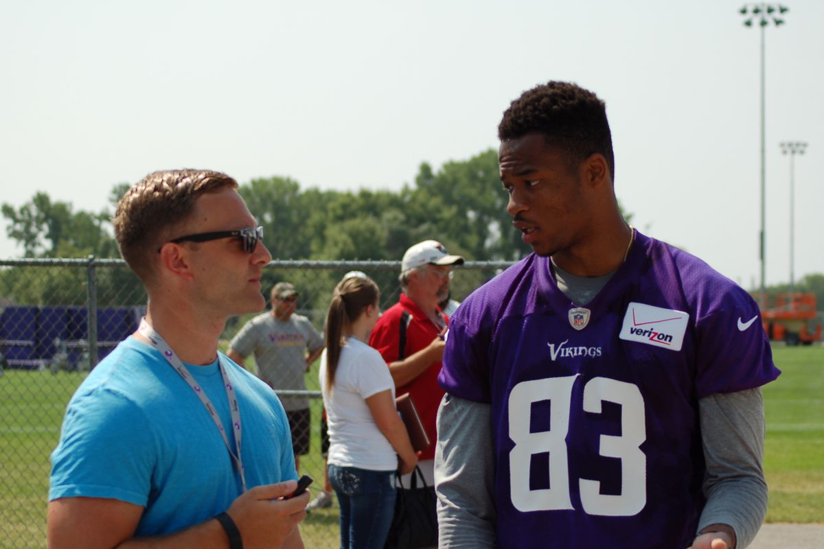 Rodney Smith being interviewed by a devilishly handsome blogger after practice Saturday.