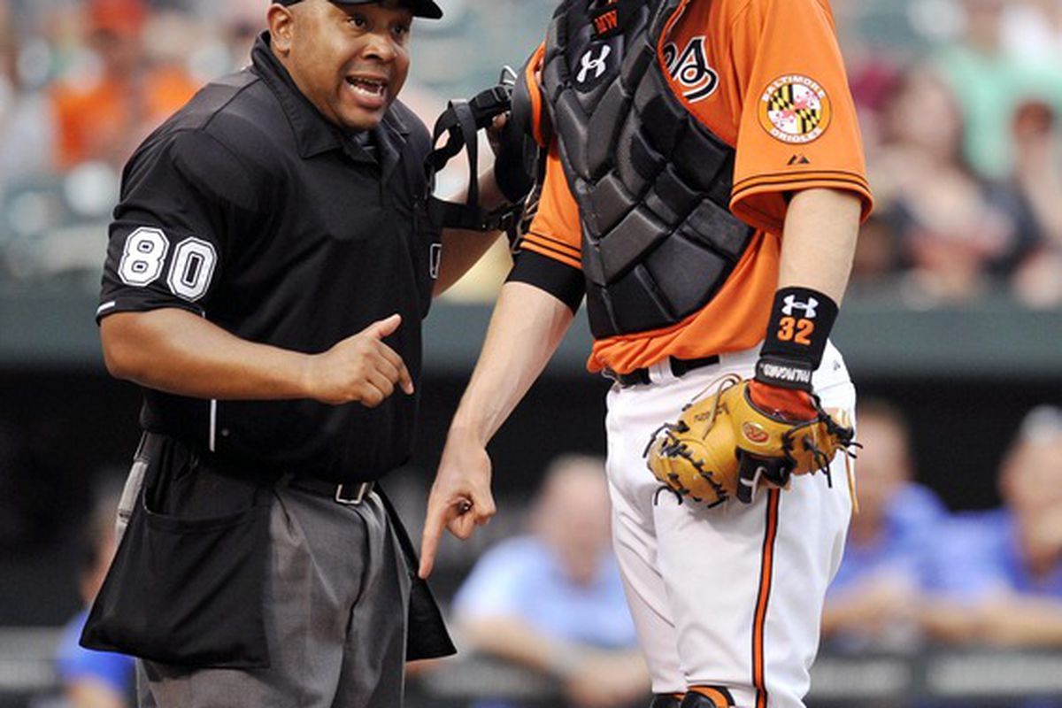 """Baltimore Orioles catcher Matt Wieters (32) argues a call with home plate umpire Adrian Johnson. I believe the words """"None shall pass!"""" were used. Mandatory Credit: Joy R. Absalon-US PRESSWIRE"""