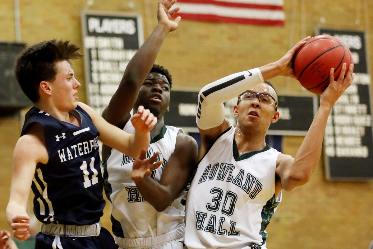 Rowland Hall's Isaiah Adams grabs a rebound away from Waterford's Connor Smith as they and Waterford play at Rowland Hall in Salt Lake City on Wednesday, Jan. 15, 2020.